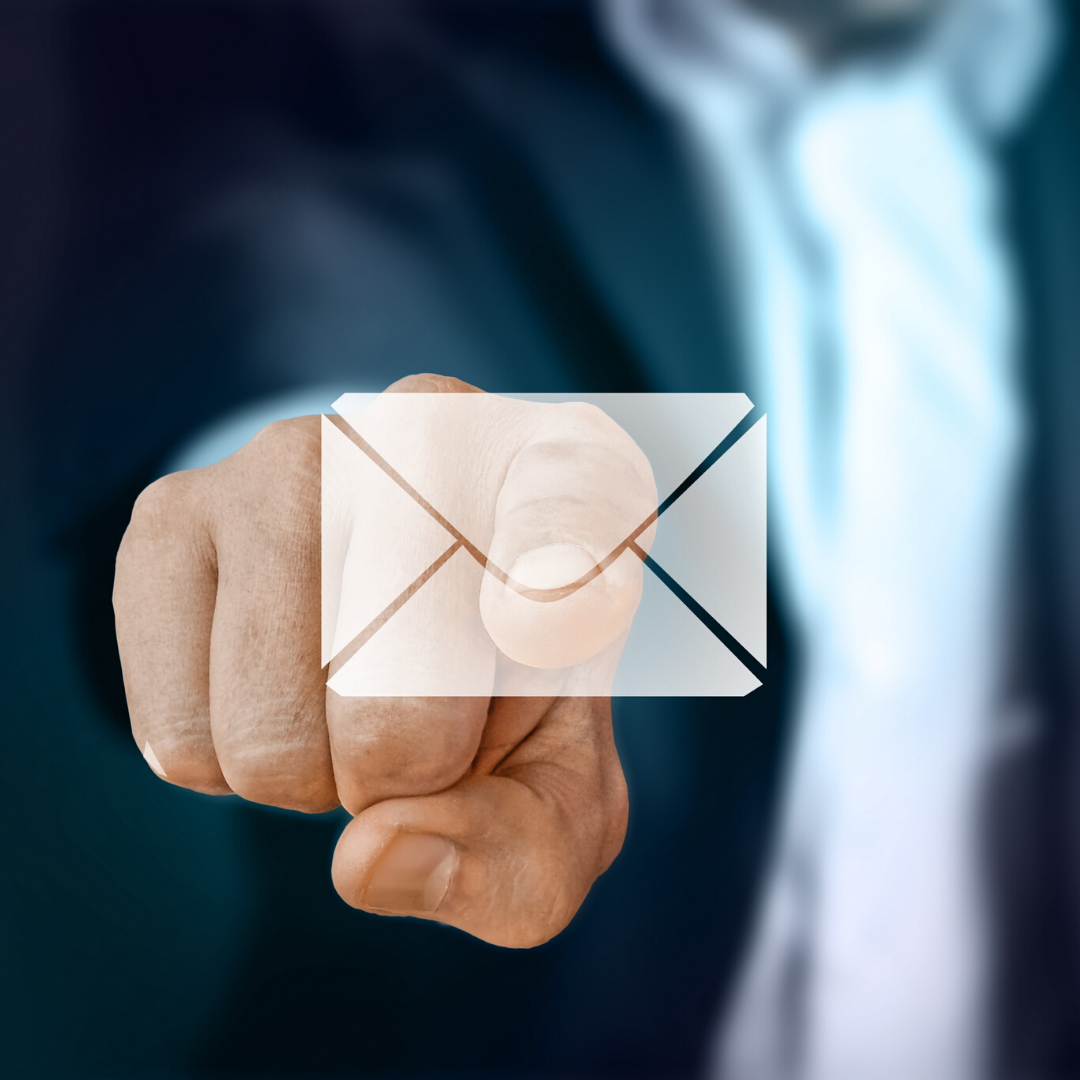 Email Marketing | a man in a dark suit pointing his finger at an email envelope